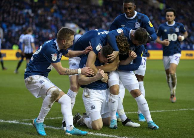 The Rovers players celebrate during the win over Sheffield Wednesday