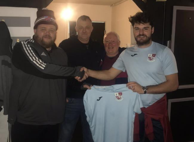 Stoneclough FC's Dean Walmsley, Rob Rostron and Peter Conroy welcome Ben Marshall, right, to the club