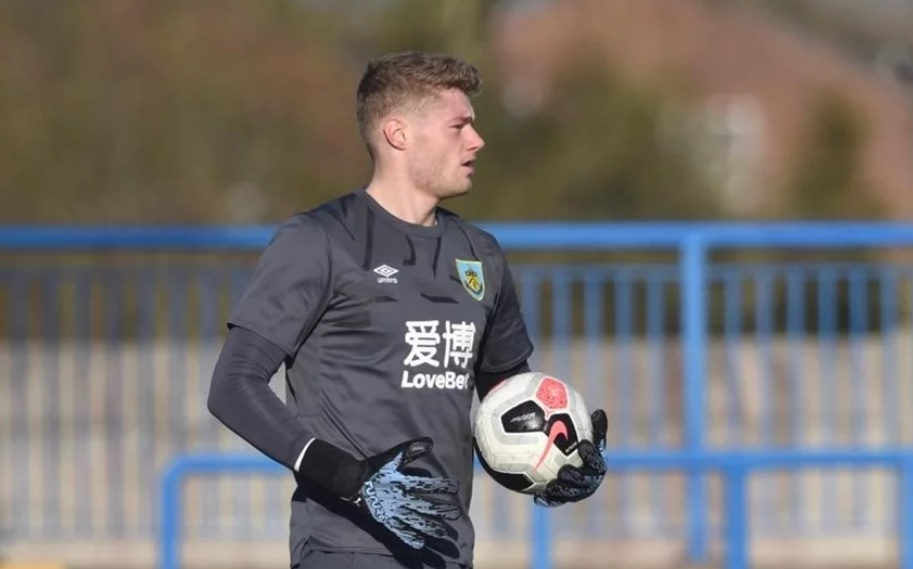 Burnley's Lukas Jensen follows Nick Pope with penalty save