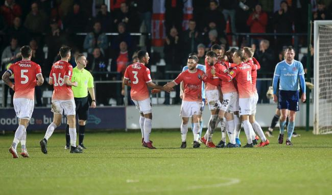Salford celebrate as Tom Elliott scores the winning goal to send Accrington Stanley out of the Leasing.com Trophy