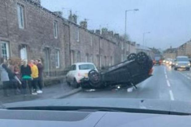 A car has flipped onto its roof while driving along the A56 Colne Road in Kellbrook. PIC CREDIT: Tracy Glegg