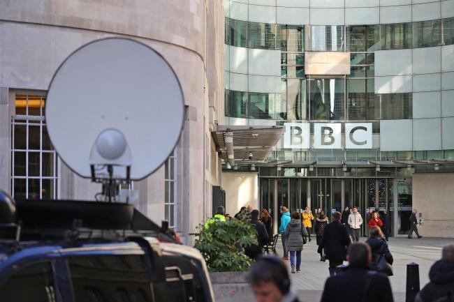 Media trucks outside BBC Broadcasting House in London, they are to announce cuts to its news division as part of a cost-cutting drive. PA Photo. Picture date: Wednesday January 29, 2020. BBC News has to save £80 million as part of financial pressure