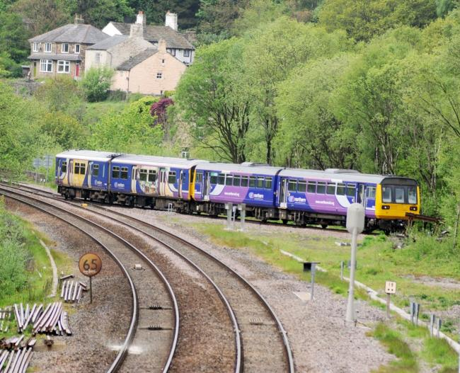 The first train on the Todmorden Curve en route between Burnley and Manchester Victoria on May 17 2015