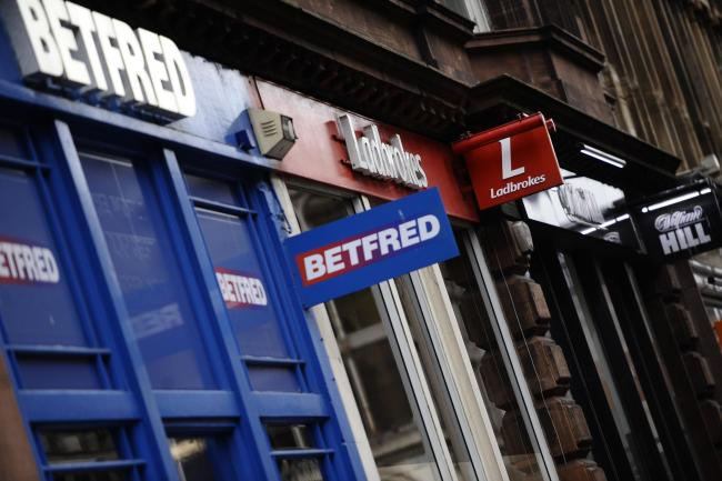 GLASGOW, SCOTLAND - DECEMBER 05: a general view of  Betfred, Ladbrokes and William Hill betting shops in Glasgow City Centre on Gordon Street on December 05, 2017 in Glasgow, Scotland. (Photo by Jamie Simpson/Herald & Times) - JS.