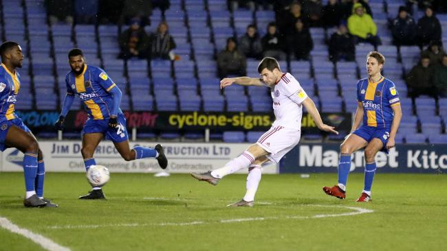 Bobby Grant put Accrington Stanley in the lead with a great strike in their 2-0 win away at Shrewsbury Town