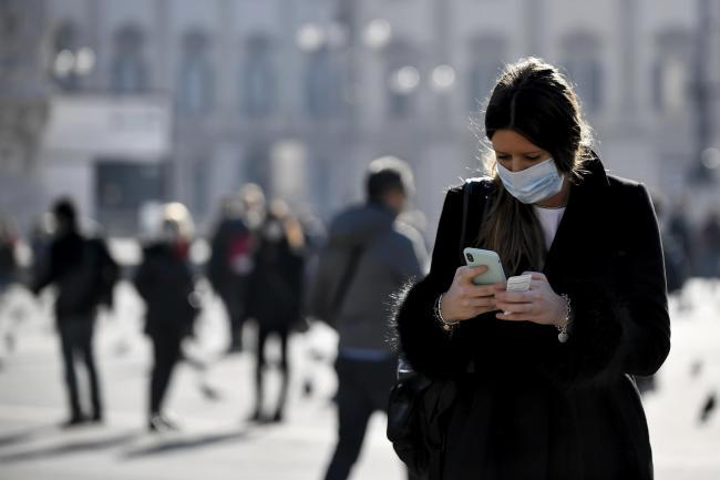 A woman wearing a mask in Milan. Pic credit: PA