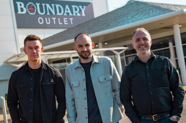 From left to right are Red-Fern Media's lead designer Kyle Craven, creative director Alex Heeney and managing director Sean Redfearn at Boundary Outlet, Colne