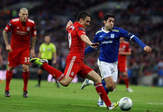 Peter Whittingham challenges Stewart Downing during the 2012 league cup final