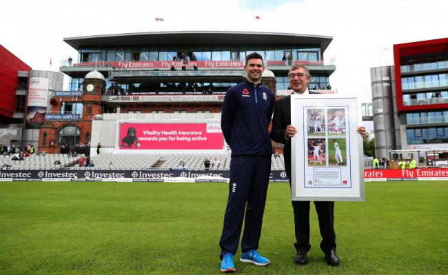 England's James Anderson is presented with a framed photo by Lancashire CCC Chairman David Hodgkiss OBE as the old Pavilion End is renamed the James Anderson End during the Fourth Investec Test at Emirates Old Trafford, Manchester.