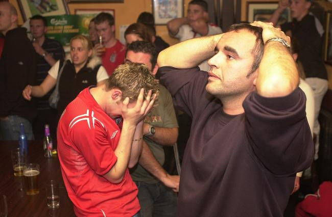 David Place and Tom McVicker in the Hargreaves Arms, Accrington, watching England go out of the Euros in 2004