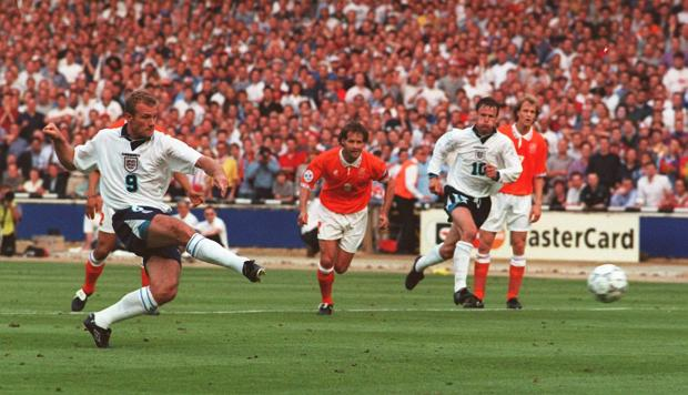 Lancashire Telegraph: GOAL: Alan Shearer scores from a penalty to open the scoring for England in tonight's Euro 96 clash against Holland at Wembley. Picture: Neil Munns/PA