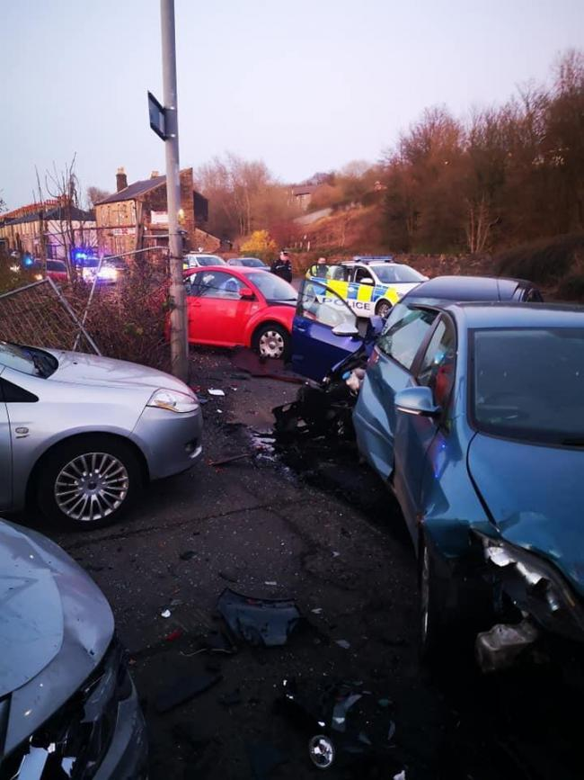 Colne Road in Brierfield on Monday night, when a car car travelling down the road crashed and damaged three parked vehicles.