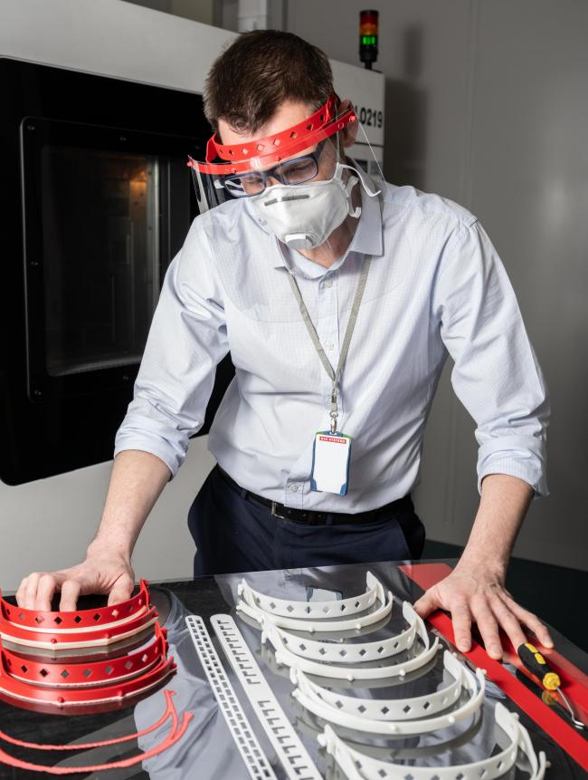 A BAE Samlesbury employee working on the 3D printing of face shields