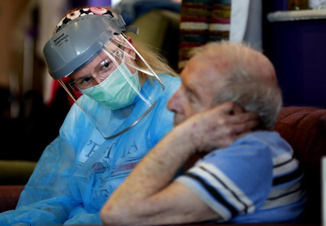 Nurse in PPE at a care home. Picture: AP/ Frank Augstein