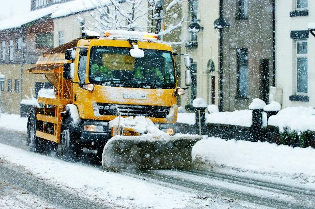 Lancashire Telegraph: PLOUGHING ON: A snow plough and gritter helps to clear roads in Bolton