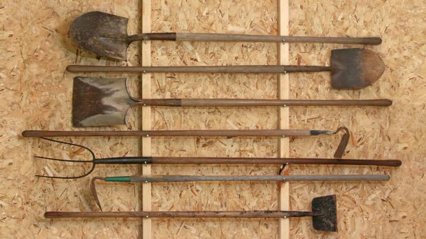 Lancashire Telegraph: Get heavy tools, rakes, shovels, etc., off the floor using utility hooks or, even, nails. Credit: Getty Images / Twoellis