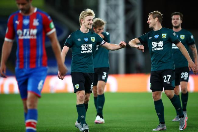 Ben Mee celebrates victory at Selhurst Park with Matej Vydra