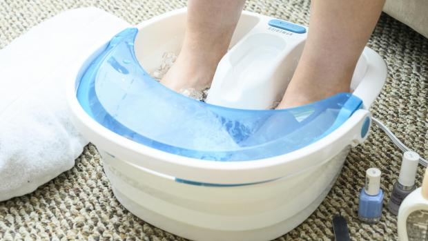 Lancashire Telegraph: Soak your feet to soften the skin around corns. Credit: Reviewed / Betsey Goldwasser