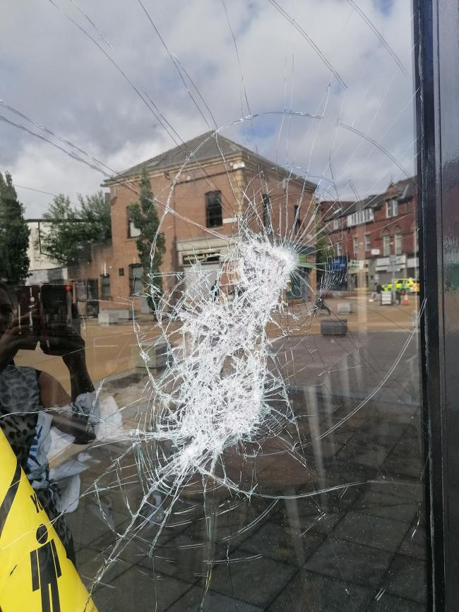 Damage to the window on Roberto's Bar and Bistro in Blackburn