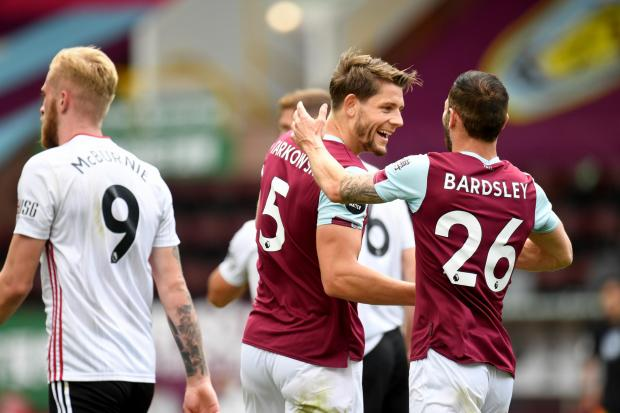 Stand-in captain James Tarkowski celebrates his goal with Phil Bardsley