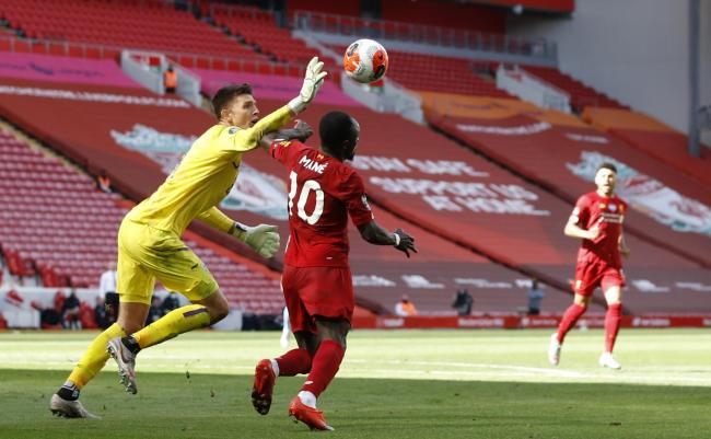Nick Pope blocks a shot from Sadio Mane at Anfield on Saturday
