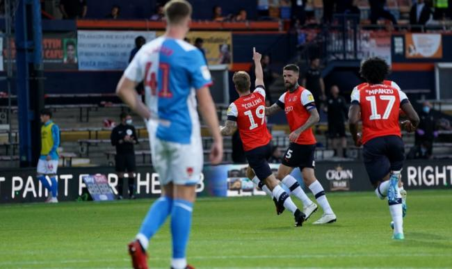 James Collins celebrates scoring from the spot in Luton's win over Rovers