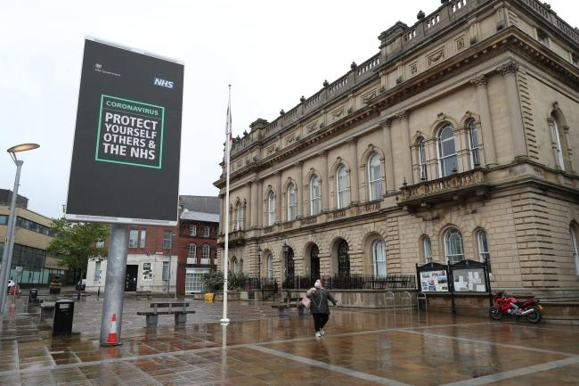 An advisory from the UK Government on a billboard in Blackburn town centre. (PA)
