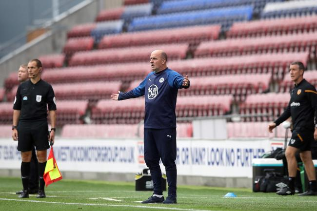 Paul Cook spent three years in charge at Wigan Athletic