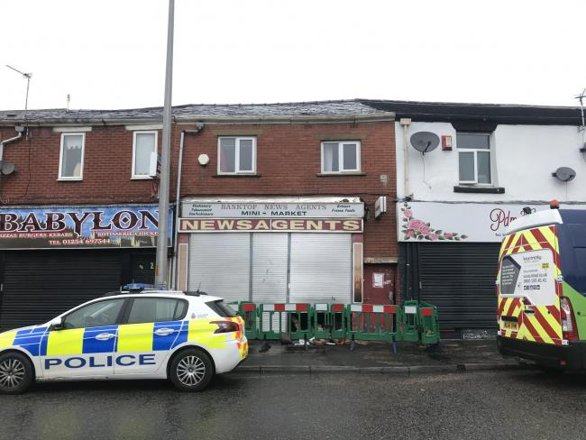 A car has ploughed into a row of shops opposite St Wilfrid's in Blackburn