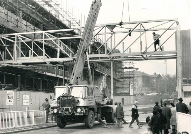 The bridge over Ainsworth Street, Blackburn, connecting the market to the shopping centre being lifted into place in 1970