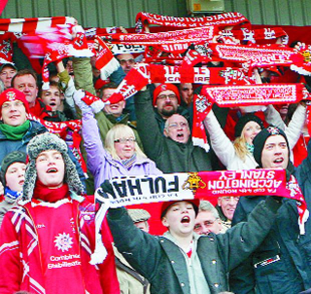 Lancashire Telegraph: CHEER WE GO: Accrington Stanley fans were out in force and in good voice as they cheered the Reds on during the FA Cup fourth round clash with Fulham at a packed Crown Ground                                                               Pictures: KIPAX