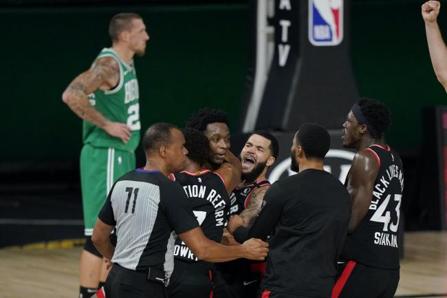 Team-mates mob Toronto Raptors' OG Anunoby