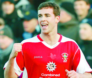 Accrington Stanley boss desperate to keep strike star Symes