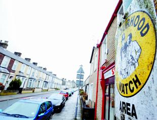CRIME FEAR: A  'Watch' sticker in St Matthew Street, Burnley, aimed at warning off burglars