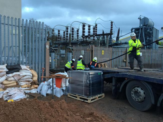Ready: Electricity North West engineers installing a new power cable