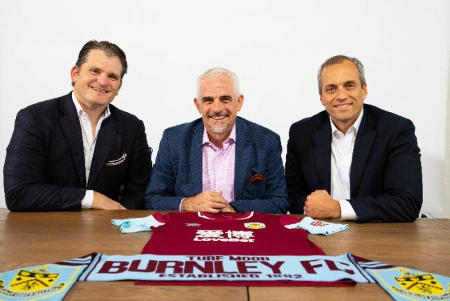 New Burnley chairman Alan Pace, centre