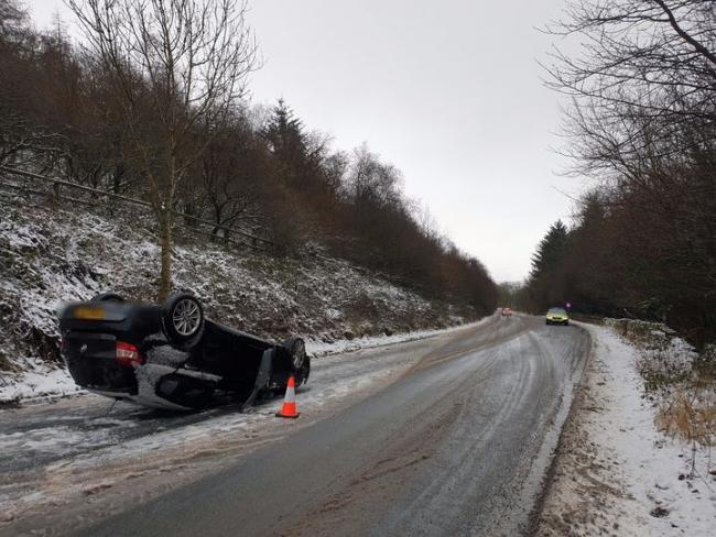 Car flips onto roof in Grane Road smash as heavy snow causes morning chaos