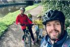 John Rutherford and family on a bike ride