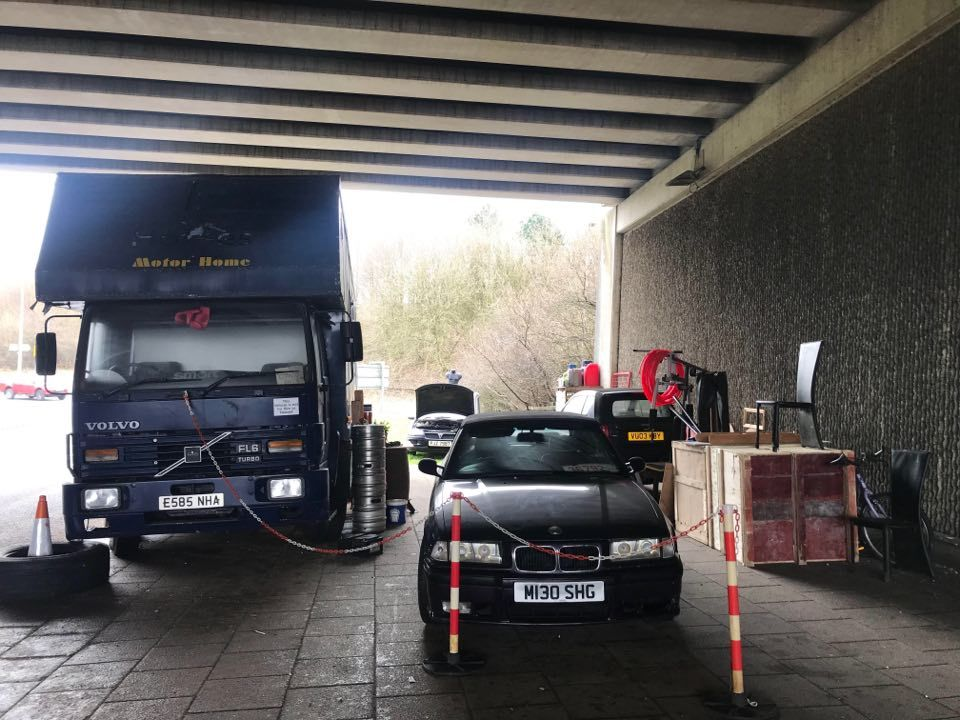 A mystery man has set up home under the motorway bridge at Darwen Services, leaving residents puzzled about why hes chosen that precise location