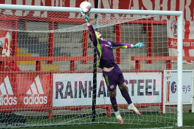 Accrington 'keeper Toby Savin in action against Swindon