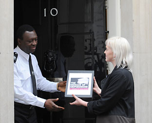 Press reporter Jennifer Bell hands over the petition calling for a ban on mephedrone at 10 Downing Street. Picture: Stefan Rousseau/PA