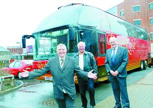 ALL ABOARD! From left, Coun Peter Britcliffe, Doug Hayes and Roy Atkinson with the Red Rose Travel bus