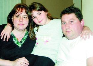 'DEVASTATING' NEWS: Debbie and Clive Macken with their daughter Katie who is treated at Burnley General Hospital