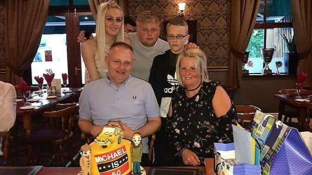 Lancashire Telegraph: Michael and his family on his birthday (Photo: Jodie Sutcliffe)