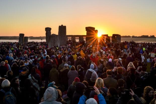 Lancashire Telegraph: People watching the sunrise at Stonehenge (Ben Birchall/PA)