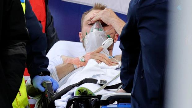 Lancashire Telegraph: Christian Eriksen leaves the field after collapsing (Friedemann Vogel/Pool via AP)