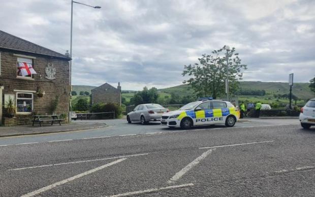 Lancashire Telegraph: Police closed Holcombe Road near Haslingden on Thursday night following a smash