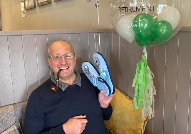 Stuart Ingleby with his retirement gifts from the team at Specsavers, Lord Street Mall, Blackburn