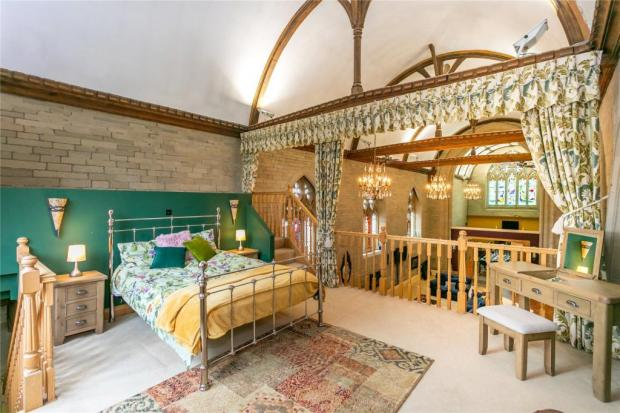 Lancashire Telegraph: The master bedroom (Photo: Rightmove/Fine and Country)