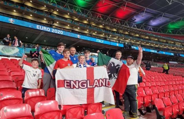 Lancashire Telegraph: The Cavallo, Ceraldi and Bellusci families from Blackburn and Rishton enjoying the Italy win at Wembley during the Euro 2020 final